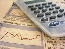 Carta y calculadora financieras Imágenes de archivo libres de regalías