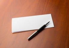 Carta y pluma Fotografía de archivo libre de regalías