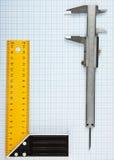 Cartabón y calibrador imagen de archivo