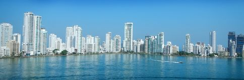 Cartagena city skyline. With speed boat passing and skyscrapers. Picture taken in the morning stock photo