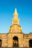 Cartagena Clock Tower Gate. Vertical view of the clock tower gate at sunrise in the historic center of Cartagena, Colombia Stock Images