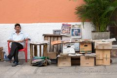 A local newspaper vendor at the street of Cartagena, Colombia. stock photos