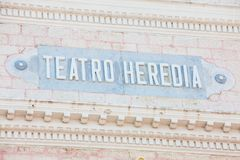 The antique sign of the Heredia Theater in the walled city of Cartagena de Indias. CARTAGENA DE INDIAS, COLOMBIA - AUGUST, 2018: The antique sign of the Heredia stock photography