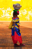 CARTAGENA DE INDIAS, COLOMBIA - JUNE 15, 2014. Colombian woman in Cartagena de Indias with the traditional dress. In Colombia is usual to transport fresh fruit Stock Images