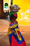 CARTAGENA DE INDIAS, COLOMBIA - JUNE 15, 2014. Colombian woman in Cartagena de Indias with the traditional dress. In Colombia is usual to transport fresh fruit Stock Photos