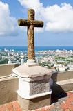 Cartagena religious cross. Religious stone cross on plinth with Cartagena cityscape in background, Colombia Royalty Free Stock Photography