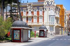 Cartagena, Spain - August 1 2018: Beautiful ornate buildings and. French style kiosks on a sunny city street in the Murcia region royalty free stock photos