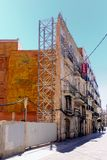 Cartagena, Spain - August 1 2018: The facade of once beautiful o. Rnate buildings, now being supported by scaffolding, on a sunny city street in the Murcia royalty free stock image