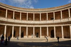 People visiting courtyard in Palacio de Carlos V in La Alhambra, Granada, Spain stock photo