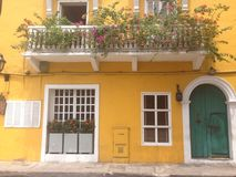 Cartagena. Yellow house in cartagena's street Royalty Free Stock Image