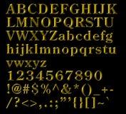 Cartas alfabéticas, números y símbolos de bronce Imagenes de archivo