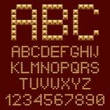 cartas de los alfabetos del oro 3d. Imagenes de archivo
