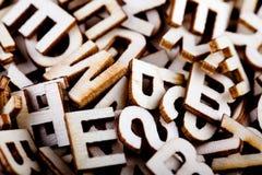 Cartas de madera embarulladas cerca para arriba Fotografía de archivo libre de regalías
