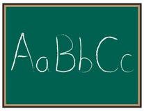 Cartas del ABC en la pizarra Foto de archivo libre de regalías