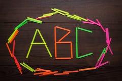 Cartas del ABC formadas con la cuenta de los palillos Imagen de archivo libre de regalías