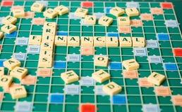 Cartas que forman la crisis financiera de las palabras Imágenes de archivo libres de regalías