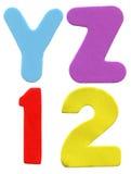 Cartas y números coloridos de la espuma Fotografía de archivo libre de regalías