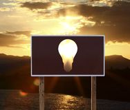 Cartaz com lâmpada Fotografia de Stock Royalty Free