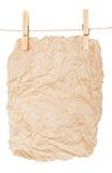 Cartaz do papel-um em pregadores de roupa Foto de Stock