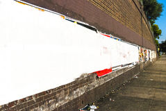 Cartazes cobertos sobre o Livro Branco Foto de Stock Royalty Free
