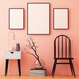 Cartazes do modelo no quadro em um fundo claro no interior 3d Foto de Stock Royalty Free