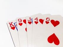Carte affleurante en jeu de poker avec le fond blanc Photos libres de droits