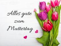 Carte allemande de jour du ` s de mère avec le mot Muttertag Photo stock