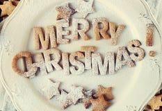 Carte avec des biscuits de pain d'épice Joyeux Noël toned Photos libres de droits
