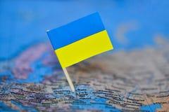 Carte avec le drapeau de l'Ukraine images stock