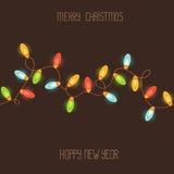 Carte avec les lumières de Noël colorées Image stock