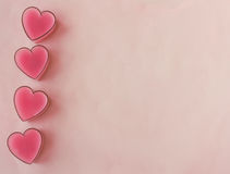 Carte avec quatre coeurs roses Photo stock