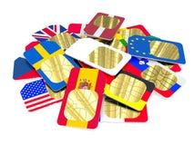Carte blanche de SIM parmi coloré photographie stock libre de droits