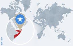 Carte bleue abstraite du monde avec la Somalie magnifiée illustration libre de droits