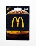 Carte cadeaux de Mcdonalds sur un fond blanc Photographie stock libre de droits