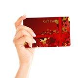 Carte cadeaux holded à la main au-dessus du blanc Image libre de droits