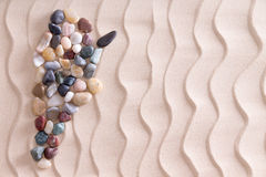 Carte créative de caillou de l'Argentine sur le sable de plage Photos libres de droits