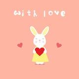 Carte d'amour, lapin avec le coeur Images stock