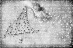 Carte d'ange avec des salutations dans beaucoup de langages Image stock