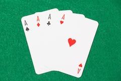 Carte da gioco - assi sulla tavola verde Fotografia Stock