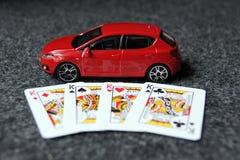4 re con l'automobile rossa Fotografia Stock