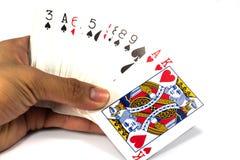 Carte da gioco a disposizione Fotografie Stock