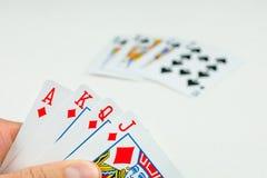Carte da gioco in poker Una carta più - sarà una vampata reale Fotografie Stock