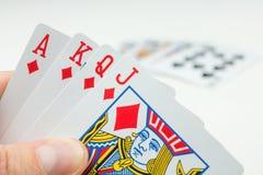 Carte da gioco in poker Una carta più - sarà una vampata reale Immagini Stock Libere da Diritti