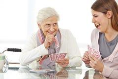 Carte da gioco senior della donna Immagine Stock Libera da Diritti