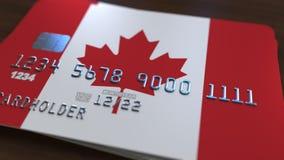 Carte de banque en plastique comportant le drapeau du Canada Rendu 3D relié au système d'opérations bancaires nationales Image libre de droits