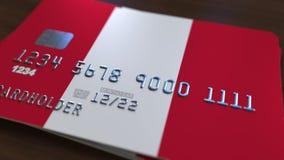 Carte de banque en plastique comportant le drapeau du Pérou Rendu 3D relié au système d'opérations bancaires nationales Images libres de droits