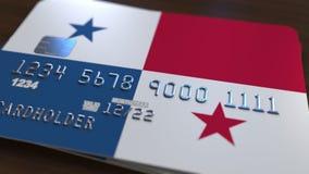 Carte de banque en plastique comportant le drapeau du Panama Rendu 3D relié au système d'opérations bancaires nationales Photo libre de droits