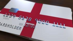 Carte de banque en plastique comportant le drapeau de l'Angleterre Rendu 3D relié au système d'opérations bancaires nationales Image libre de droits
