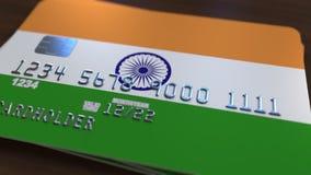 Carte de banque en plastique comportant le drapeau de l'Inde Rendu 3D relié au système d'opérations bancaires nationales Photo libre de droits