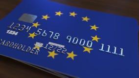 Carte de banque en plastique comportant le drapeau de l'Union européenne Rendu 3D relié au système d'opérations bancaires nationa Photographie stock